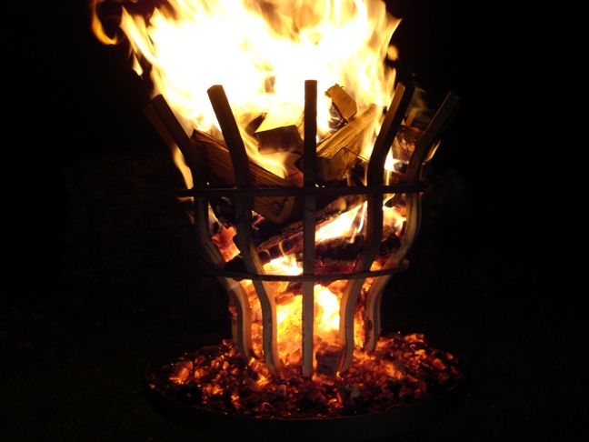 Grate Wall of Fire's tall fire pit shown throwing some serious heat